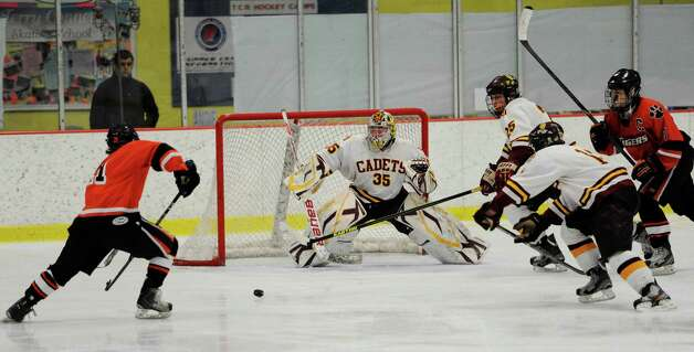 St. Joseph high school goalie Marc VanEtten faces a shot by Ridgefield high school's Cameron McGuire in the FCIAC boys ice hockey championship game held at Terry Conners Ice Rink, Stamford CT on Saturday, March 2nd, 2013 Photo: Mark Conrad / Connecticut Post Freelance