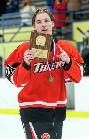 MVP of the FCIAC boys ice hockey championship game, Ridgefield high school's Cameron McGuire holds up his plaque during the awards ceremony after the game against St. Joseph high school held at Terry Conners Ice Rink, Stamford CT on Saturday, March 2nd, 2013 Photo: Mark Conrad / Connecticut Post Freelance