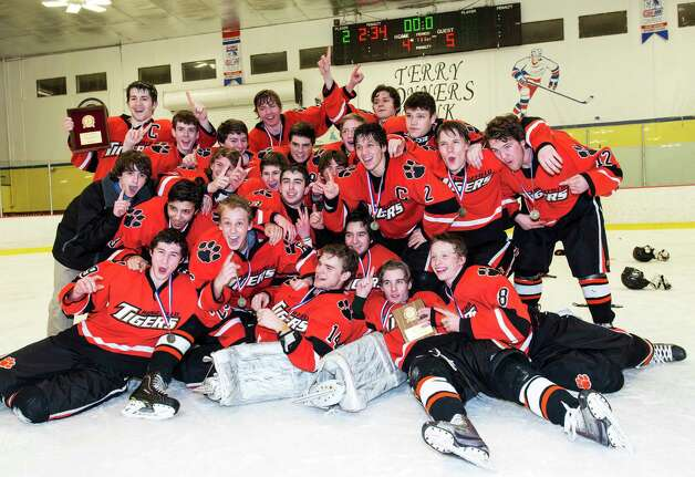 The FCIAC boys ice hockey champions, the Ridgefield high school Tigers, celebrate their win over St. Joseph high school in game held at Terry Conners Ice Rink, Stamford CT on Saturday, March 2nd, 2013 Photo: Mark Conrad / Connecticut Post Freelance
