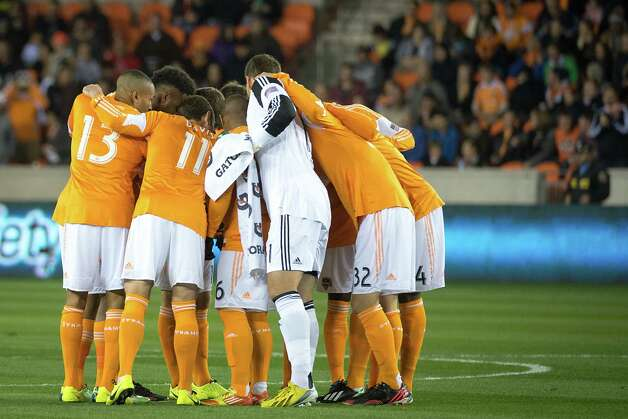 Dynamo players huddle before facing D.C. United in their season opener. Photo: Smiley N. Pool, Houston Chronicle / © 2013  Houston Chronicle