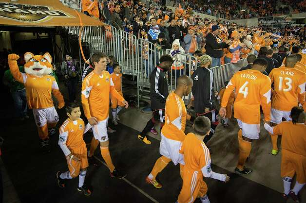 Dynamo players take the field for their season opener against D.C. United. Photo: Smiley N. Pool, Houston Chronicle / © 2013  Houston Chronicle