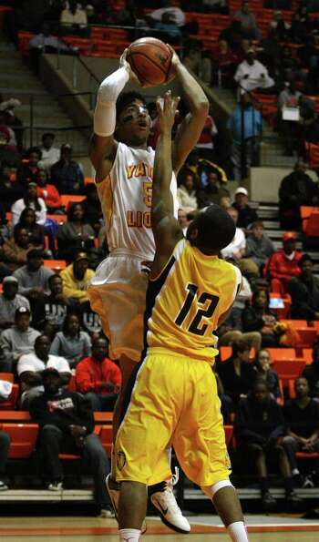 Yates' JC Washington (left) shoots over La Marque's Al Curry.