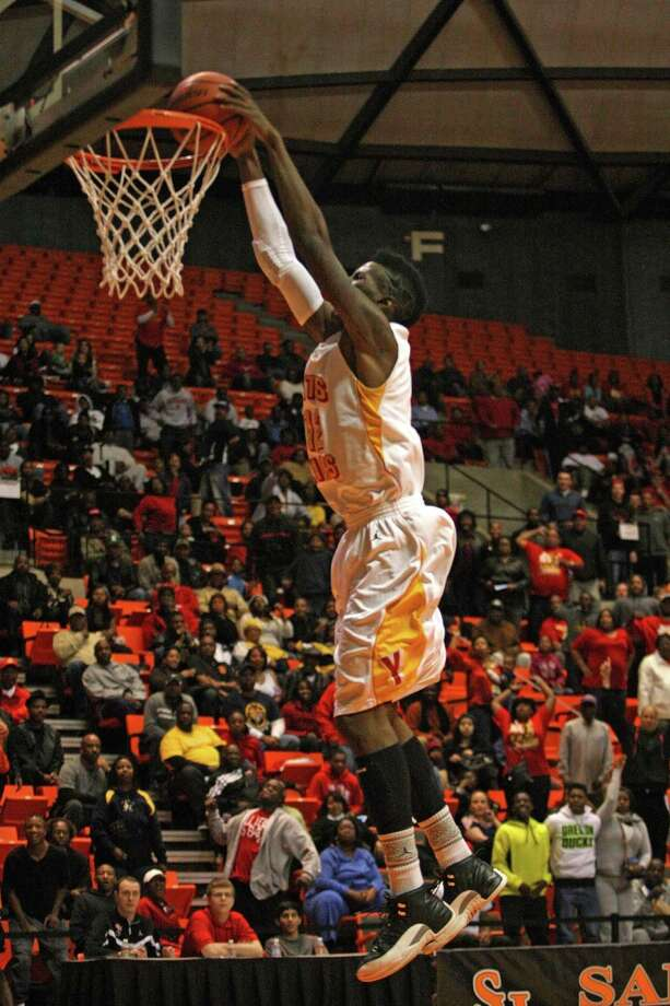Yates' Melvin Swift dunks. Photo: Eric Christian Smith, For The Chronicle