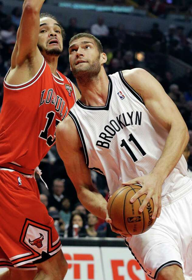 Brooklyn Nets center Brook Lopez, right, drives to the basket against Chicago Bulls center Joakim Noah during the first half of an NBA basketball game in Chicago on Saturday, March 2, 2013. (AP Photo/Nam Y. Huh) Photo: Nam Y. Huh