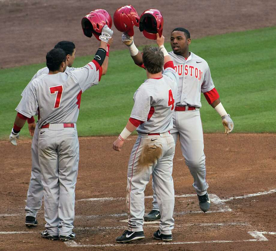 Houston's Jonathan Davis, right, is greeted at the plate after slugging a grand slam in the first inning of Saturday's 15-4 win over Baylor at Minute Maid Park. Photo: Smiley N. Pool, Staff / © 2013  Houston Chronicle