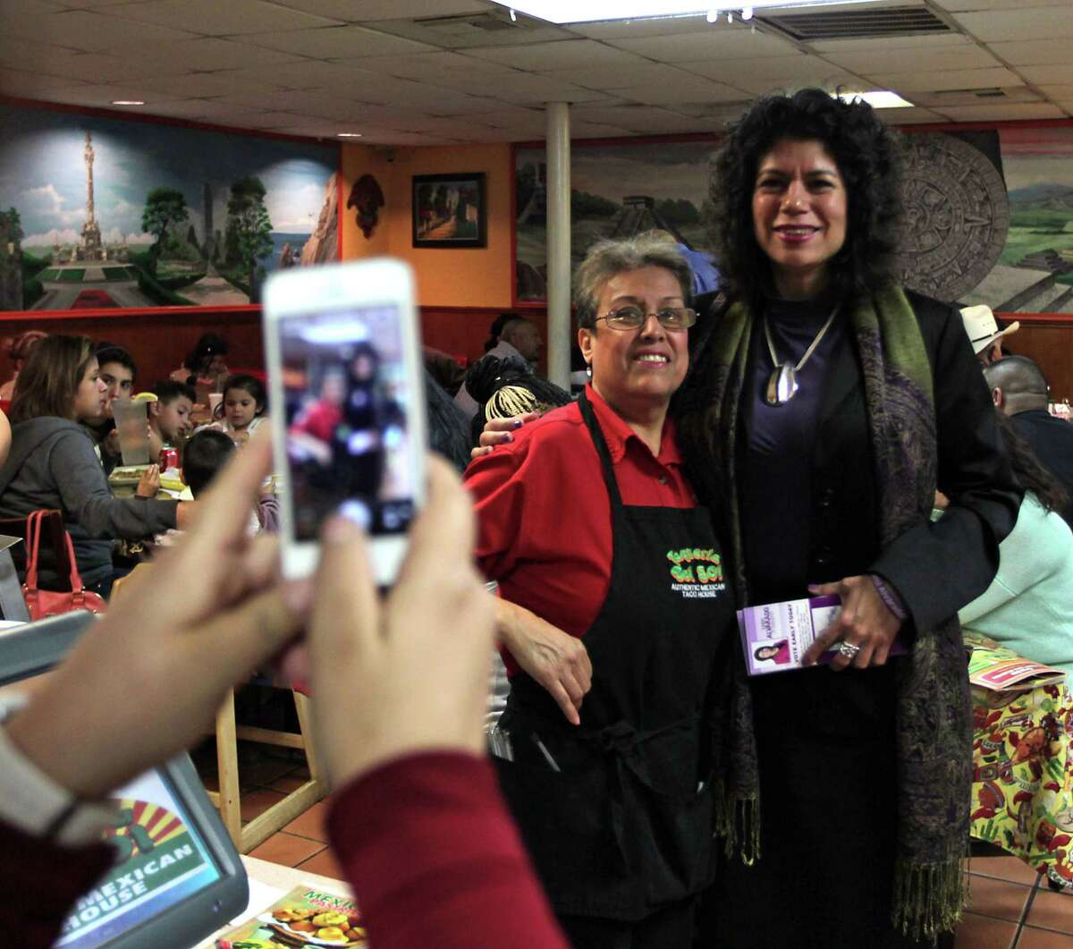 State Rep. Carol Alvarado right, poses for a photograph with Maria Schaefer at Taqueria Del Sol restaurant on Saturday. Alvarado was defeated by Sylvia Garcia in the race to fill the Texas Senate District 6 seat.