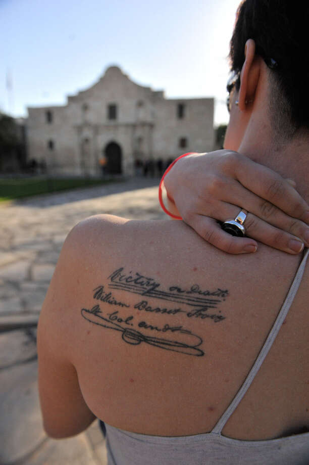 "Sarah Martin, 22, of Arlington has a replica of the ""victory or death"" quote tattooed to her back. She was at the Alamo on Friday. Photo: Robin Jerstad / For The San Antonio Express-News"