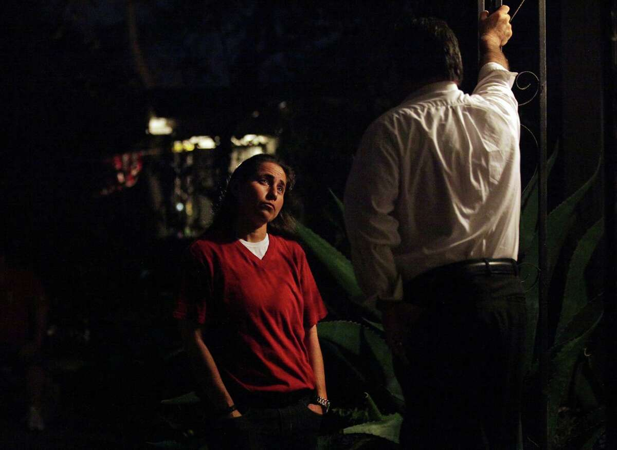 Anna Vasquez, who was paroled in November, talks with her brother Jerry Vasquez on their mother's porch.