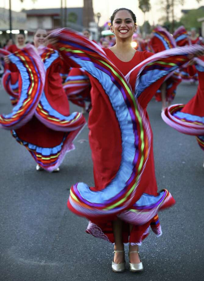 Amberly Altamirano of the Veterans Memorial High School Chargerettes dances at the beginning of the Illuminated Parade during Charro Days in Brownsville. Photo: Bob Owen / San Antonio Express-News
