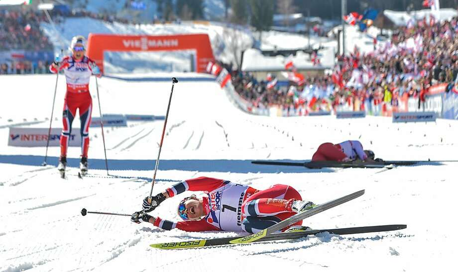 Norway's Marit Bjoergen (C) celebrates her first place on March 2, 2013 in the finish area, next to Norway's Therese Johaug (L) and Poland's Justyna Kowalczyk (R), at the end of the Women's Cross Country 30 km Classic race of the FIS Nordic World Ski Championships at Val Di Fiemme Cross Country stadium in Cavalese, northern Italy. Photo: Andreas Solaro, AFP/Getty Images
