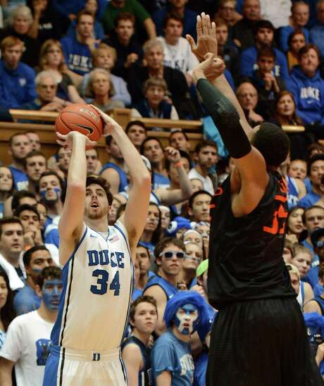 Duke's Ryan Kelly shoots over Miami's Kenny Kadji in the second half. Kelly scored 36 points after missing the past 13 games with a foot injury. Photo: Chuck Liddy / Raleigh News & Observer