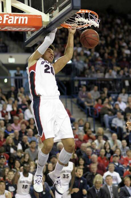 Gonzaga's Elias Harris dunks against Portland in the second half. Harris led Gonzaga with 20 points. Photo: Jed Conklin / Associated Press