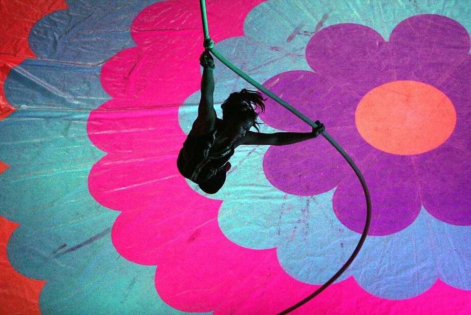 A performer swings on a rope during an act at the Piccadilly Family Circus at The Forum in Rome, Ga. on  Saturday, March 2, 2013. Photo: Brittany Hannah, Associated Press