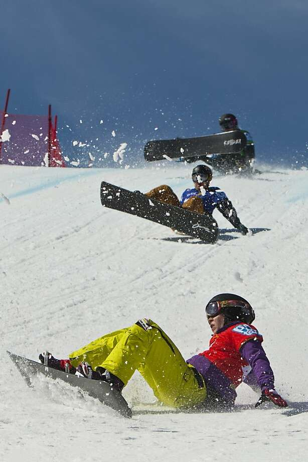 Simona Meiler, Callan Chythlook-Sifsof and Brooke Shaw wipe out while competing during the U.S. Snowboardcross Grand Prix at Canyons Resort, Saturday March 2, 2013, in Park City, Utah. Photo: Chris Detrick, Associated Press