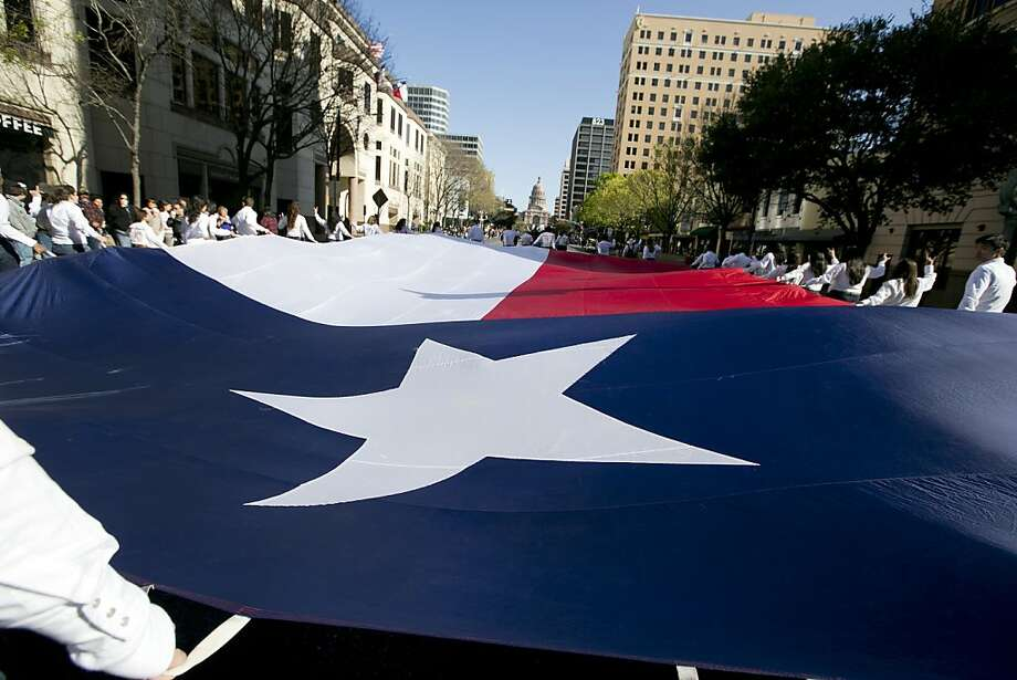 Members of the Alpha Phi Omega service fraternity from  the University of Texas carry the Texas flag during the Texas Independence Day parade up Congress Avenue in Austin, Tx., on Saturday, March 2, 2013. Photo: Deborah Cannon, Associated Press