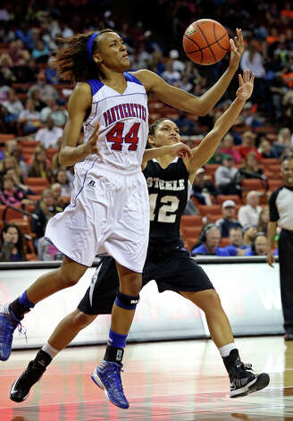 Duncanville center Antoina Robinson controls on Chelsey Leck as Steele plays Duncanville in the state championship game at the Erwin Center  on March, 2013. Photo: TOM REEL, Express-News