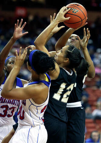 Chelsey Leck goes up in a crowd for a shot as Steele plays Duncanville in the state championship game at the Erwin Center  on March, 2013. Photo: TOM REEL, Express-News
