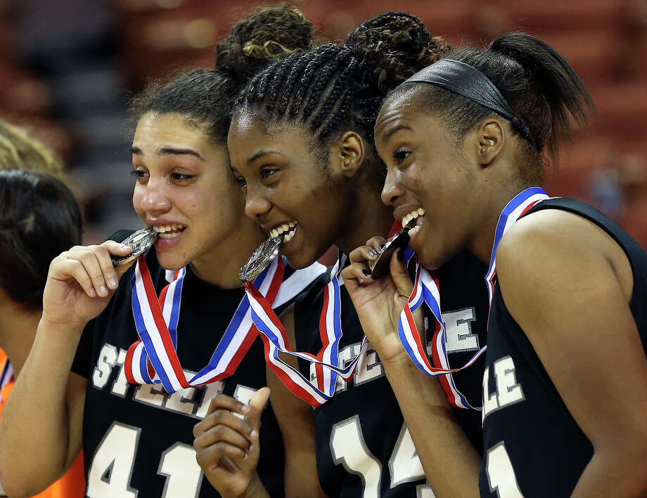 Brianna Millet (from left), McKenzie Calvert and Erika Chapman make the best of receiving their second place medals as Steele loses to  Duncanville in the state championship game at the Erwin Center  on March, 2013. Photo: TOM REEL, Express-News