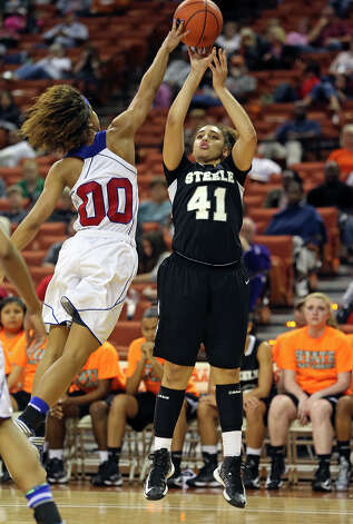 Brianna Millet gets blocked by Kiara Perry as Steele plays Duncanville in the state championship game at the Erwin Center  on March, 2013. Photo: TOM REEL, Express-News