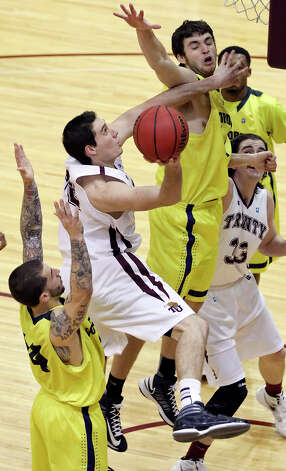 Trinity's Zach Lambert shoots between Concordia's Josh Sanchez (left) and Concordia's Brett DeMetrotion during second half action Saturday March 2, 2013 at Sams Gym on the Trinity University campus. Concordia won 87-83. Photo: Edward A. Ornelas, Edward A. Ornelas / San Antonio Express-News / © 2013 San Antonio Express-News