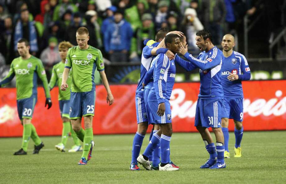 Montreal Impact player Andre Pisanu (31) celebrates with teammates after a goal by Davy Arnaud in the first half of an MLS match against the Seattle Sounders. The Impact won 1-0. Photo: JOSHUA TRUJILLO / SEATTLEPI.COM
