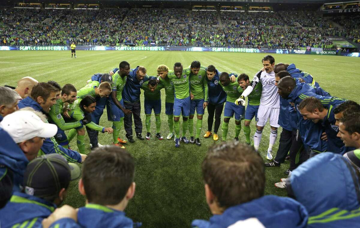 Seattle Sounders players gather on the pitch before the start of a match against the Montreal Impact-and their 2013 MLS season-on Saturday, March 2, 2013 at CenturyLink Field in Seattle. The Sounders lost to the Impact 1-0.