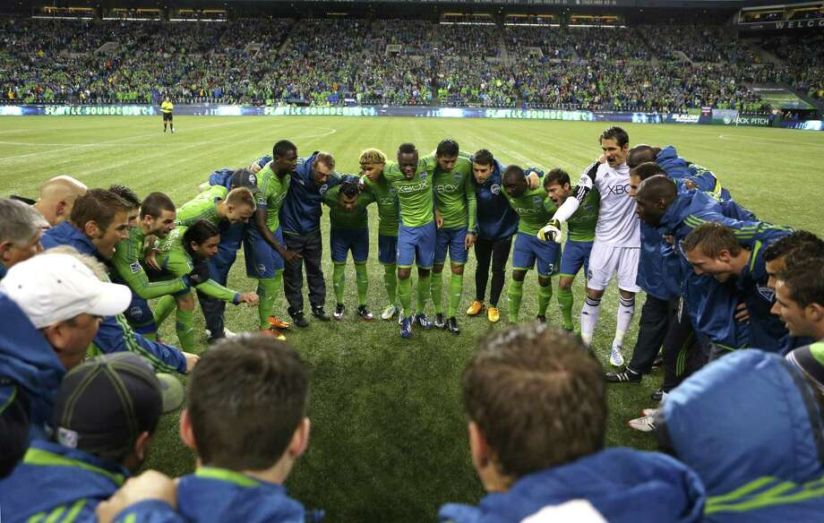 3b4b87ee45e Seattle Sounders players gather on the pitch before the start of a match  against the Montreal