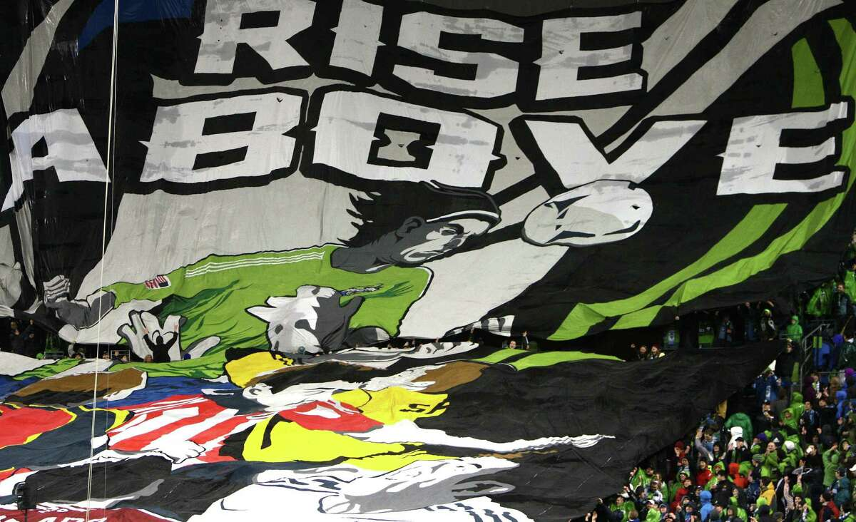 Seattle Sounders fans unveil a giant tifo before the season opening match against the Montreal Impact.