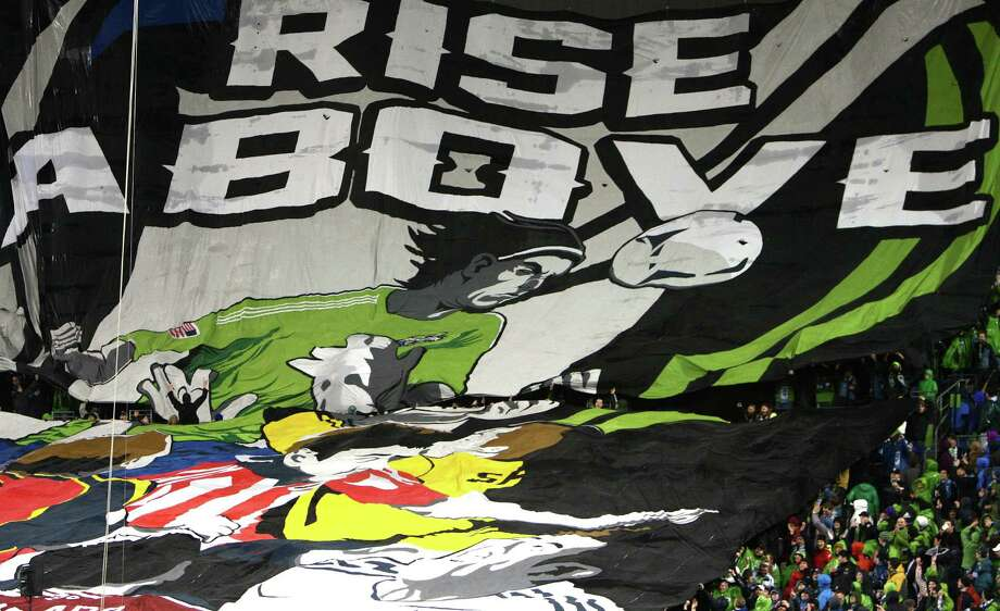 Seattle Sounders fans unveil a giant tifo before the season opening match against the Montreal Impact. Photo: JOSHUA TRUJILLO / SEATTLEPI.COM