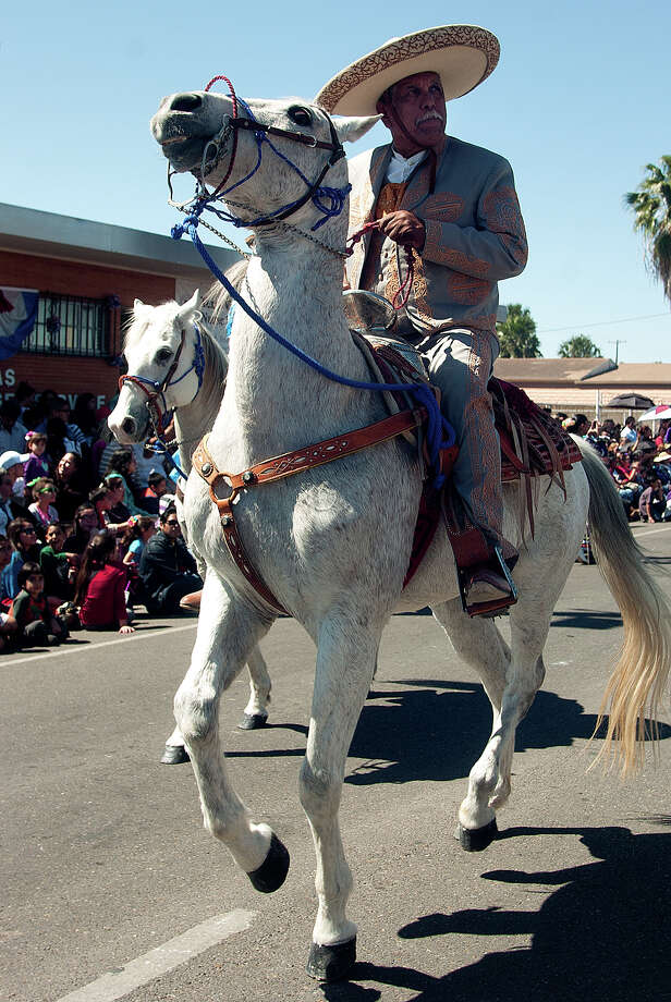 Many horsemen take part in the Grand International Parade on Saturday, March 2, 2013 along Elizabeth Street in Brownsville. Photo: Paul Chouy, AP Photo/The Brownsville Herald / The Brownsville Herald