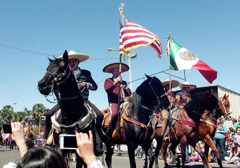 Horsemen bearing flags took part in the Grand International Parade on Saturday, March 2, 2013 along Elizabeth Street in Brownsville. Photo: Paul Chouy, AP Photo/The Brownsville Herald / The Brownsville Herald