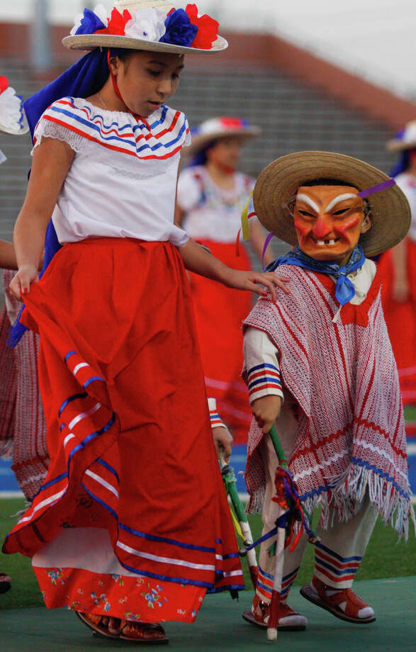 In this Monday, Feb. 25, 2013 photo, Skinner Elementry students danced Los Viejitos from the Mexican state of Michoacan during Brownsville Independent School District's annual Fiesta Folklorica at Sams Memorial Stadium in Brownsville, Texas. Several schools participated in the event that celebrated music and dances from Mexico. Photo: Yvette Vela, AP Photo/The Brownsville Herald / The Brownsville Herald