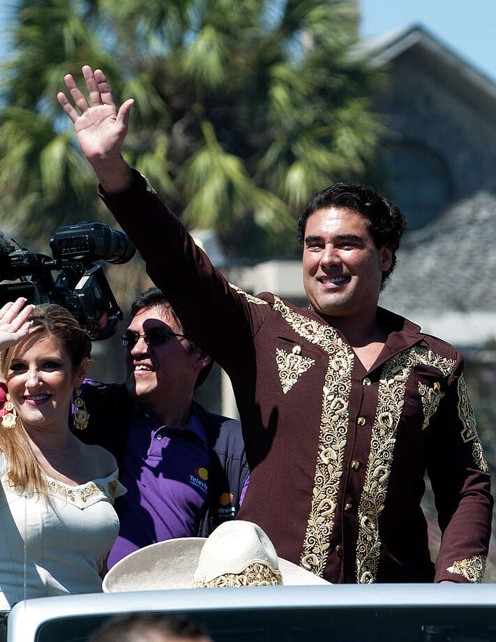 Mr. Amigo Eduardo Yanez, a television and film actor from Mexico City, waves from a vehicle during the Grand International Parade on Saturday, March 2, 2013 along Elizabeth Street in Brownsville. Photo: Paul Chouy, AP Photo/The Brownsville Herald / The Brownsville Herald