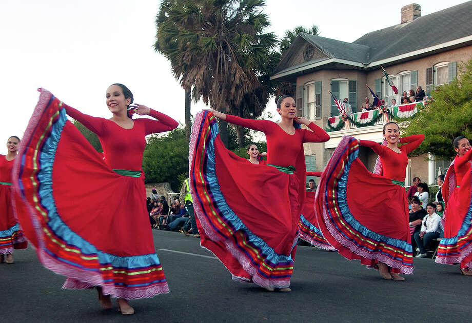 Veterans Memorial High School dancers perform in the Charro Days Illuminated Parade on Friday, March 1, 2013 along Elizabeth Street in Brownsville. Photo: Paul Chouy, AP Photo/The Brownsville Herald / The Brownsville Herald