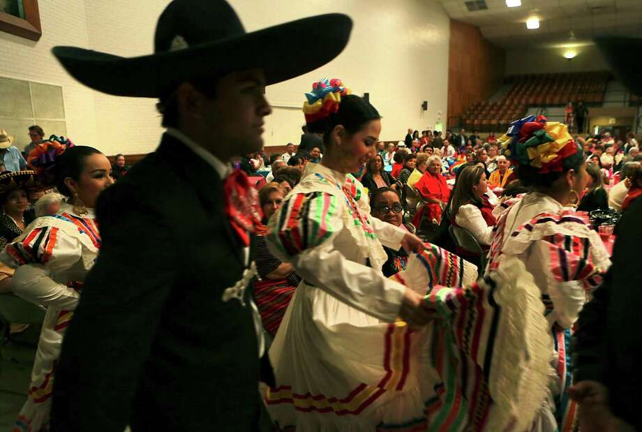 Dancers from Gloria G. Canales Mexican Folklore School of Dance in Harlingen, prepare to perform at the Noche de Fiesta Dance during Charro Days Fiesta in Brownsville, TX on Thursday, Feb. 28, 2013 at Jacob Brown Auditorium. Photo: Bob Owen, San Antonio Express-News / ©2013 San Antonio Express-News