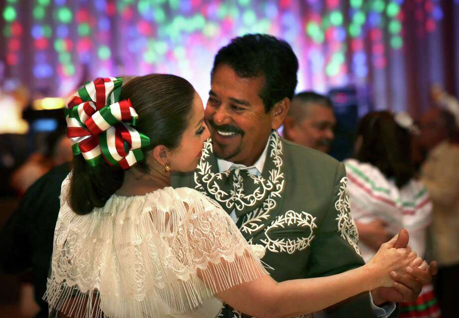 Alfredo De La Fuente and Mary Trevino, dressed in traditional Mexican clothing, enjoy a dance at Noche de Fiesta Dance during Charro Days Fiesta in Brownsville, TX on Thursday, Feb. 28, 2013 at Jacob Brown Auditorium. Photo: Bob Owen, San Antonio Express-News / ©2013 San Antonio Express-News