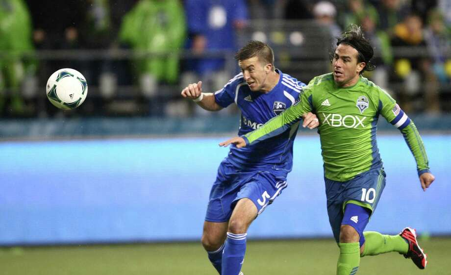 Seattle Sounders player Mauro Rosales and Montreal Impact player Jeb Brovsky battle for control of the ball. Photo: JOSHUA TRUJILLO / SEATTLEPI.COM