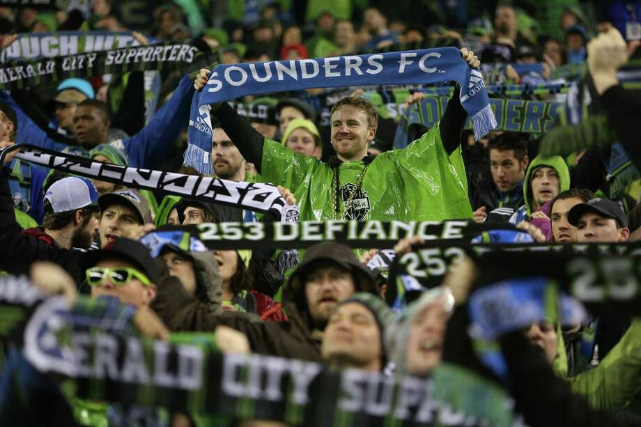 Seattle Sounders fans raise their scarves against the Montreal Impact. Photo: JOSHUA TRUJILLO / SEATTLEPI.COM