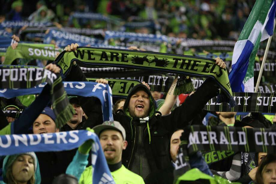 Seattle Sounders fans raise their scarves. Photo: JOSHUA TRUJILLO / SEATTLEPI.COM