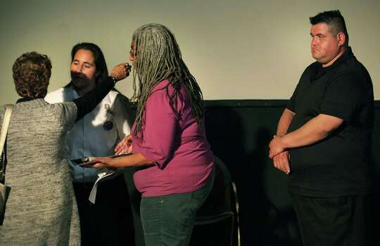 "Anna Vasquez, recently released on parole, speaks at a Work-In-Progress screening of ""San Antonio Four"" a documentary by Deborah S. Esquenazi, about Vasquez and three of her friends, who are still in prison, found guilty of sexual assault of two minors. Thursday, Nov. 15, 2012.  Her brother, Chis Vasquez, right, is her unofficial guard, making sure she is OK as friends greet her. Photo: Bob Owen, San Antonio Express-News / © 2012 San Antonio Express-News"