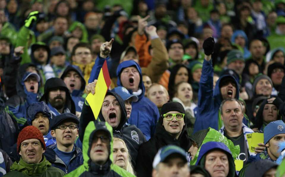 Seattle Sounders fans argue an official's call late in a match against the Montreal Impact.