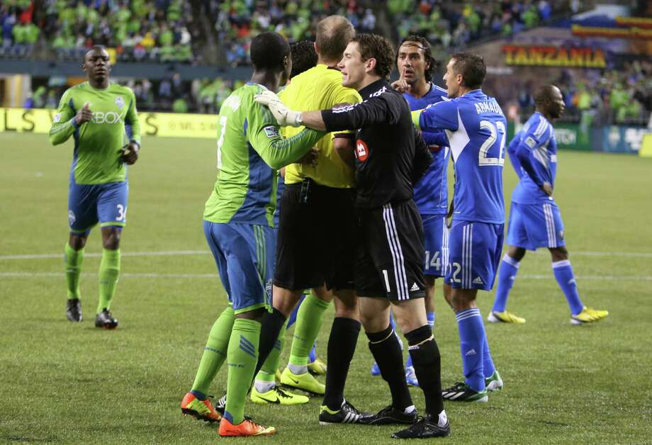 Officials work to separate players during a shoving match between Seattle Sounders players and Montreal Impact players late in the second half. Photo: JOSHUA TRUJILLO / SEATTLEPI.COM