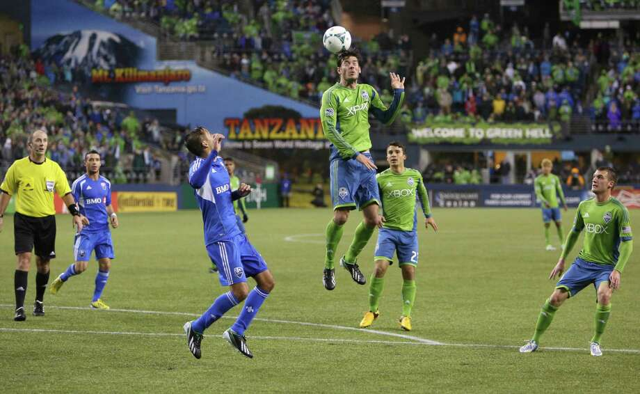 Seattle Sounders player Brad Evans heads the ball against the Montreal Impact. Photo: JOSHUA TRUJILLO / SEATTLEPI.COM