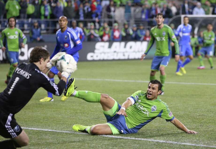 Seattle Sounders player Sammy Ochoa is stopped at the goal by Montreal Impact keeper Troy Perkins in the second half. Photo: JOSHUA TRUJILLO / SEATTLEPI.COM