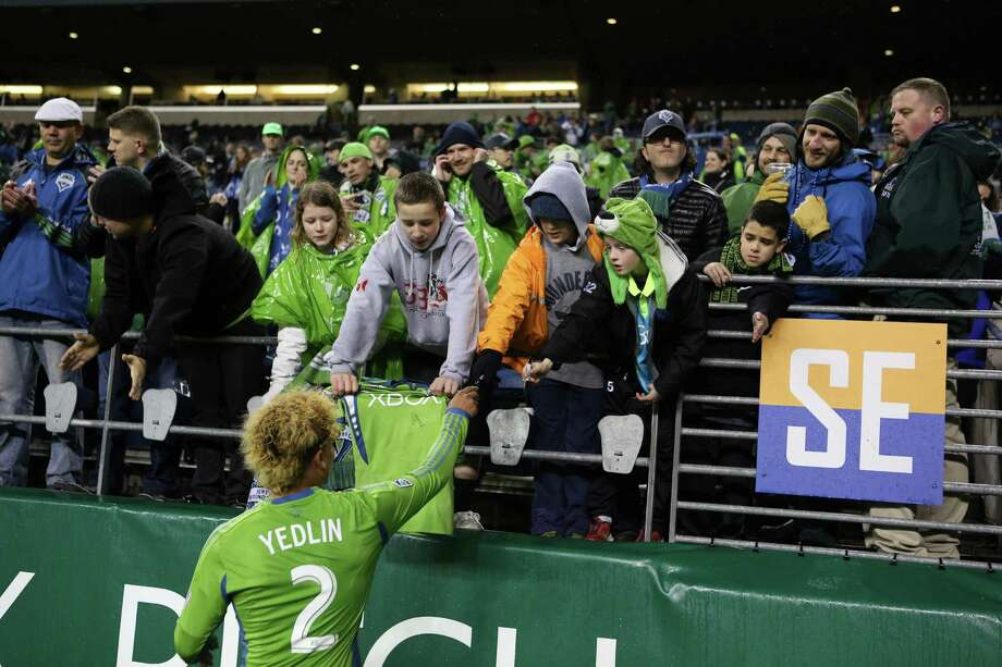 Seattle Sounders player DeAndre Yedlin signs autographs during the Sounders season opener on Saturday, March 2, 2013 at CenturyLink Field in Seattle. Photo: JOSHUA TRUJILLO / SEATTLEPI.COM