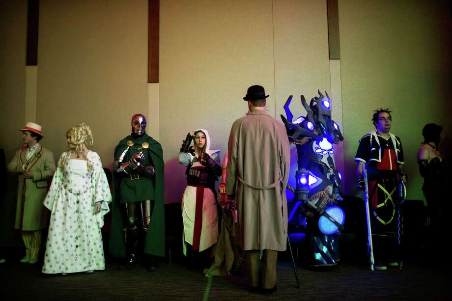 Costumed attendees line up for the competition registration on the second day of the annual Emerald City Comicon on Saturday, March 2, 2013, in the Washington State Convention Center in Seattle, Wash. Photo: JORDAN STEAD / SEATTLEPI.COM