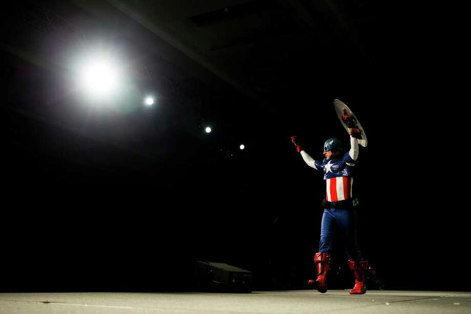 Tom Bartlett, dressed as Captain America, shows off his costume to the panel of judges on the second day of the annual Emerald City Comicon on Saturday, March 2, 2013, in the Washington State Convention Center in Seattle, Wash. Photo: JORDAN STEAD / SEATTLEPI.COM