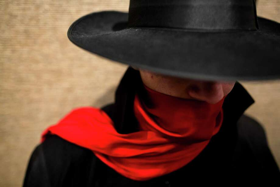 A mysterious attendee awaits costume competition registration on the second day of the annual Emerald City Comicon on Saturday, March 2, 2013, in the Washington State Convention Center in Seattle, Wash. Photo: JORDAN STEAD / SEATTLEPI.COM