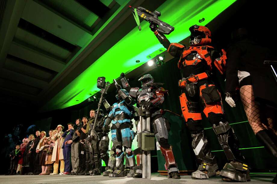 Spartan soldiers from the Halo video game, right, celebrate their first place victory in the video game bracket of the costume competition on the second day of the annual Emerald City Comicon on Saturday, March 2, 2013, in the Washington State Convention Center in Seattle, Wash. Photo: JORDAN STEAD / SEATTLEPI.COM