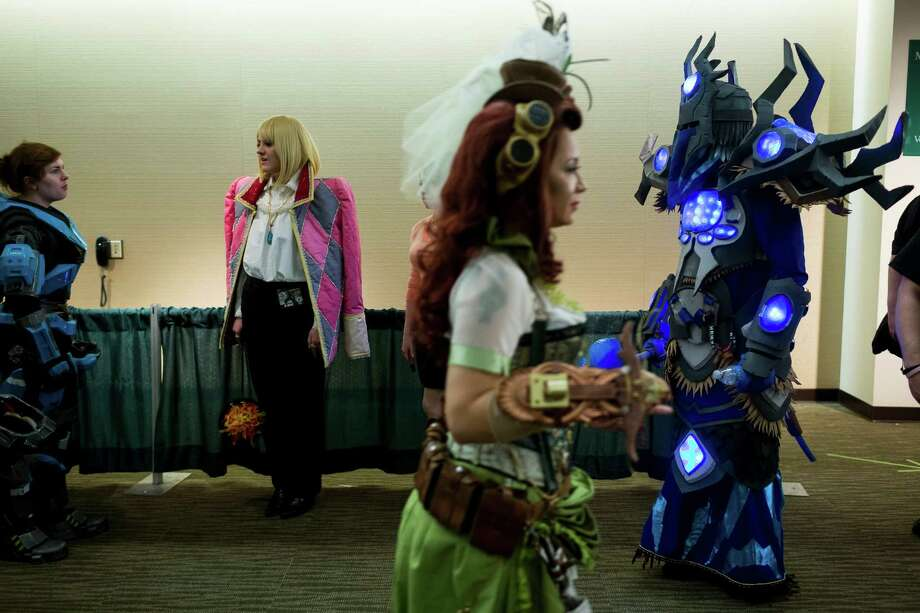 Brian Morris, right, dressed as the Draena Shaman from World of Warcraft, wanders the halls with other costumed folk on the second day of the annual Emerald City Comicon on Saturday, March 2, 2013, in the Washington State Convention Center in Seattle, Wash. Morris walked away with 1000 dollars in prize money. Photo: JORDAN STEAD / SEATTLEPI.COM
